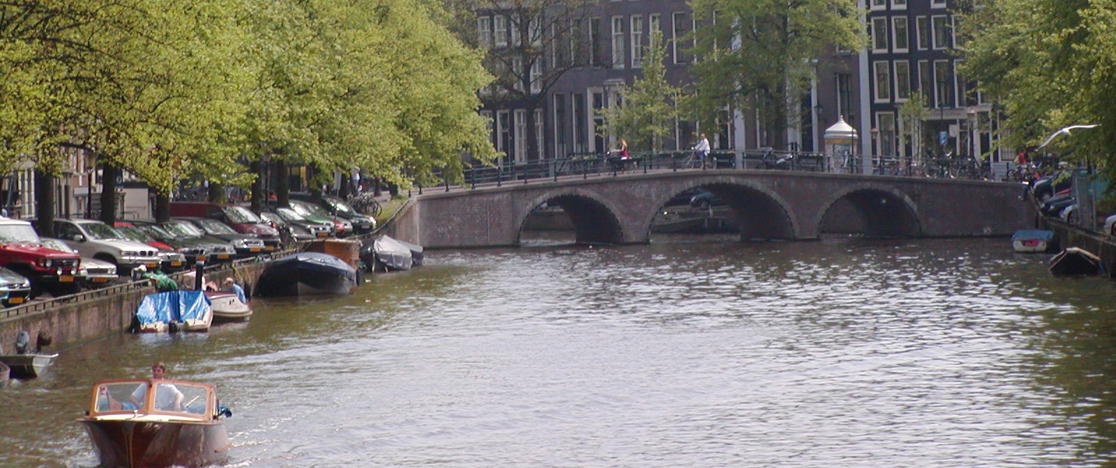 A photograph overlooking a canal in Amsterdam
