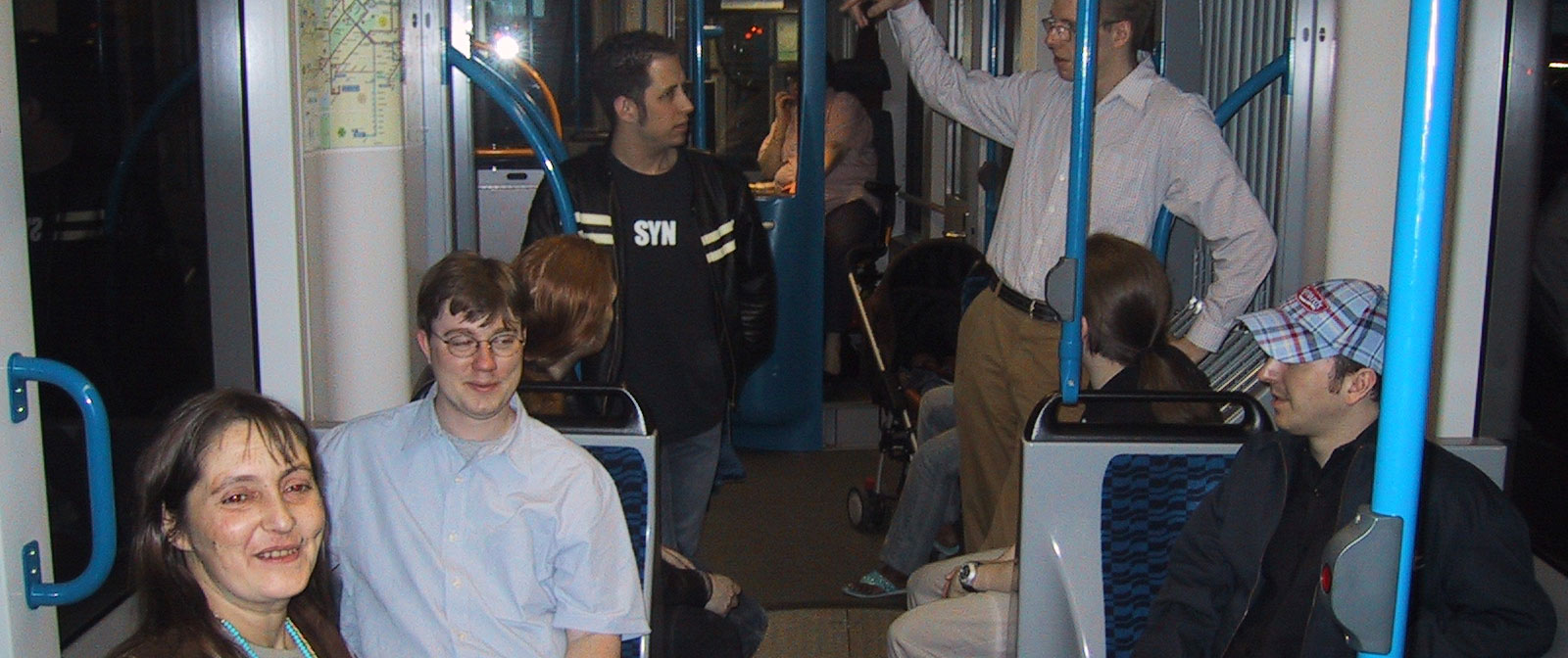 A photograph of PHP developers on a tram in Amsterdam
