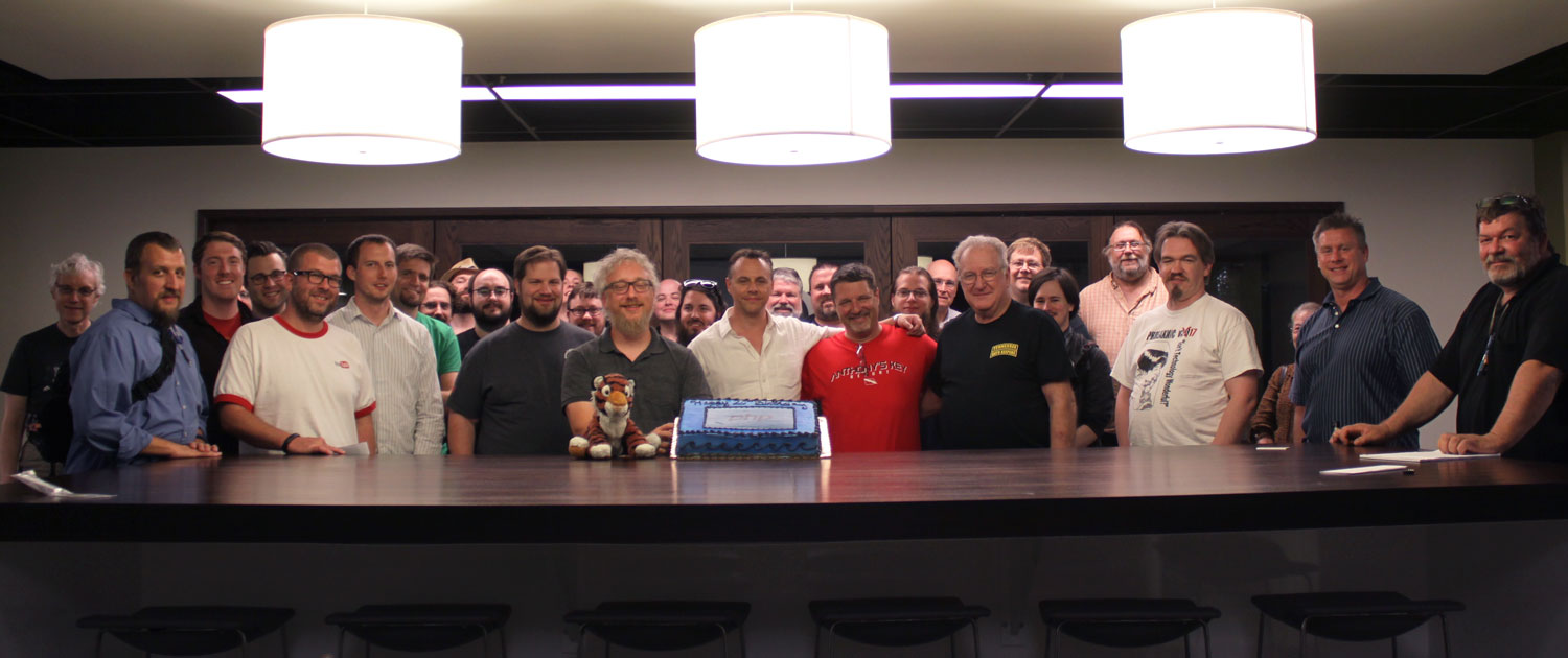 Nashville PHP members with PHP cake