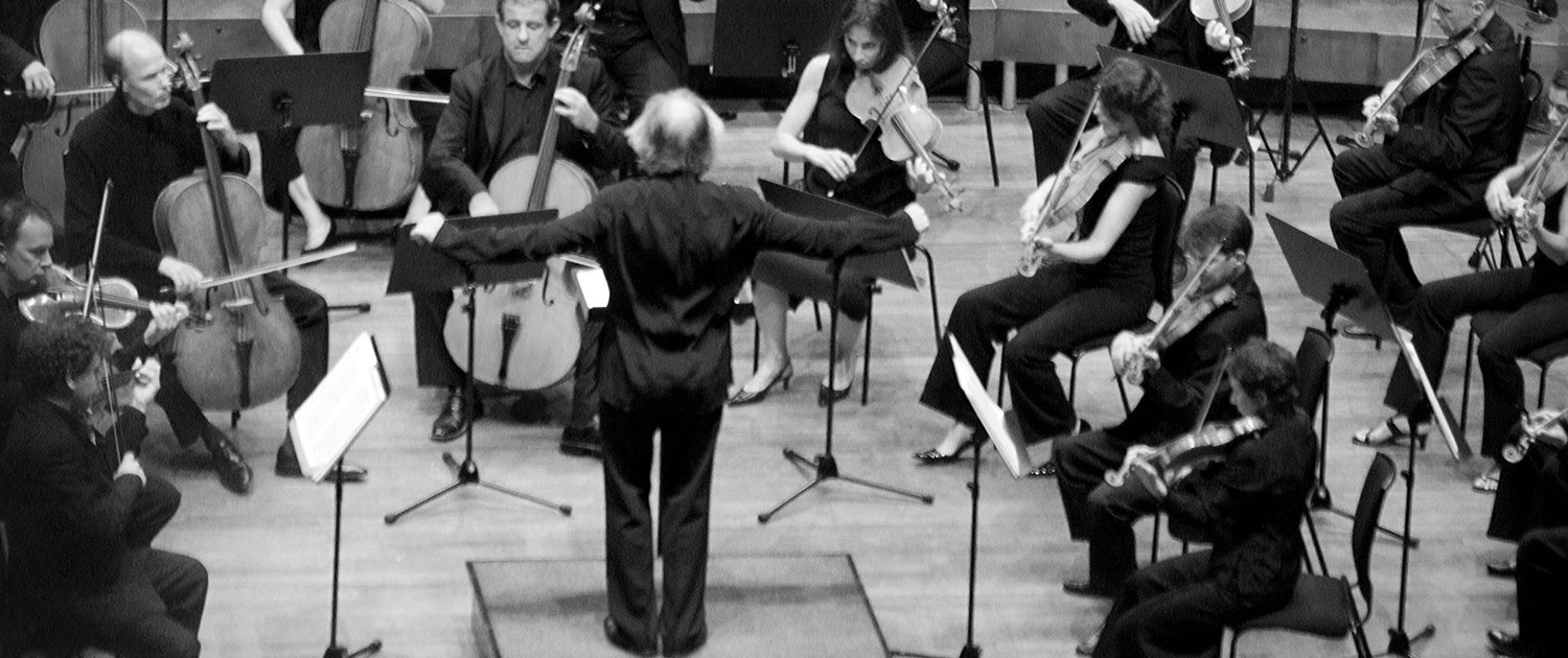 A conductor conducting an orchestra